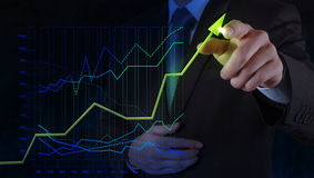 Businessman hand drawing virtual chart business on. Touch screen computer as concept stock images