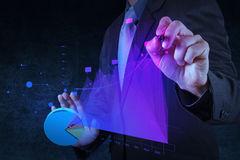 Businessman hand drawing virtual chart business on touch screen Royalty Free Stock Photography