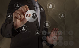 Businessman hand drawingsearch engine optimization SEO Stock Photography