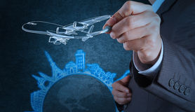 Businessman hand draws airplane travel around the world royalty free stock photos