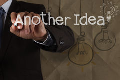 Businessman hand draws another idea light bulb with recycle enve Royalty Free Stock Photos