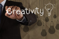 Businessman hand draws big idea light bulb Royalty Free Stock Images
