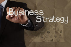Businessman hand draws business strategy Royalty Free Stock Photo
