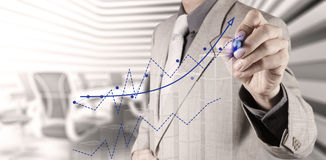 Businessman hand draws business success chart Royalty Free Stock Photo