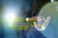 Businessman hand draws business success Stock Photos