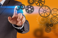 Businessman hand draws gear to success Stock Photos