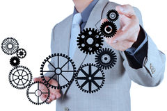 Businessman hand draws gear to success concept Stock Photo