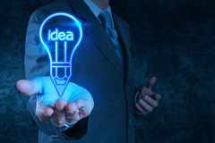 Businessman hand draws lightbulb Stock Photo