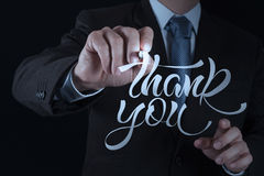 Businessman hand drwing design word. THANK YOU royalty free stock photography