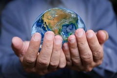 Businessman hand with the earth, Elements of this image are furnished Royalty Free Stock Photo