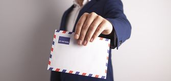Businessman hand envelope stock photography