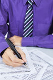 Businessman hand filling out a tax form Royalty Free Stock Photos