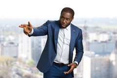 Businessman hand forefinger pointing with fingers. Afro american young manager with hand gesture pointing direction. The director gives instruction Stock Image