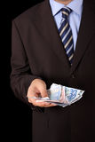 Businessman with hand full of money Royalty Free Stock Photos