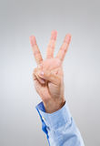 Businessman hand gesture show number three Stock Photos