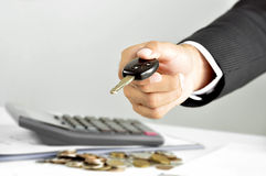 Businessman hand giving a car key Stock Images