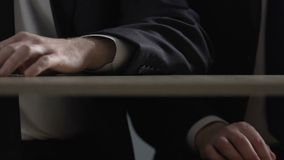 Businessman hand giving cocaine dose under table, illegal drug trafficking. Stock footage stock video