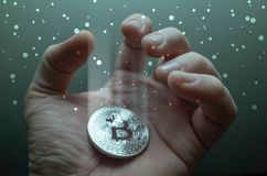 Businessman hand grab bitcoin coin in light stream. Double exposure photo. Businessman hand grab bitcoin coin in light stream. double exposure photo Royalty Free Stock Photo