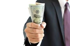 Businessman hand grabbing money, US dollar (USD) bills Stock Photos