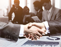 Businessman. A hand for  handshake. Make  deal. Work business team in the background Stock Photos