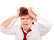 Businessman with hand on head in crisis. Royalty Free Stock Image