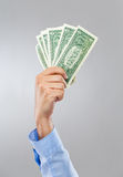 Businessman hand hold lots of US dollar Royalty Free Stock Image