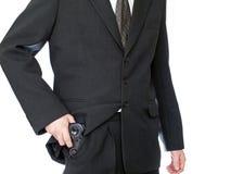 Businessman hand hold video gamepad like a gun Royalty Free Stock Photos