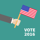 Businessman hand holding american flag. President election day 2016. Voting concept.  Green background Flat design Card. Vector illustration Stock Photos