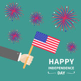 Businessman hand holding american flag. Star and strip. Firework set. Happy Independence day 4th of july Flat design. Green backgr. Ound. Vector illustration Stock Photography