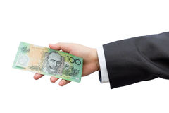 Businessman hand holding Australian dollars (AUD) on isolated ba Stock Photography