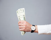 Businessman hand holding bills of US dollar Stock Photography