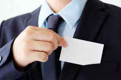 Businessman hand holding blank white business card with copy spa Stock Images