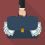 Businessman hand holding briefcase full of money Royalty Free Stock Photos
