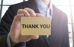 Businessman hand holding a business card with message thank you Stock Photo