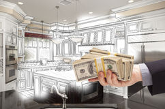 Businessman Hand Holding Cash Over Kitchen Design Drawing and Photo Combinat. Hand Holding Stacks of Money Over Custom Kitchen Design Drawing and Photo stock illustration