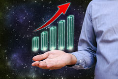 Businessman hand with holding chart that is glowing and growing. Royalty Free Stock Images