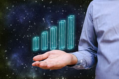 Businessman hand with holding chart that is glowing and growing. Stock Images