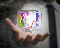 Businessman hand holding colorful transparent glass cubic Royalty Free Stock Photos