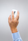 Businessman hand holding computer mouse Royalty Free Stock Image