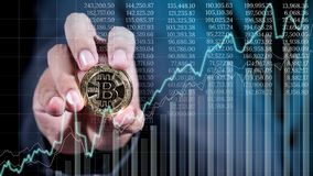 Businessman hand holding crytocurrency bitcoin with business gra stock image
