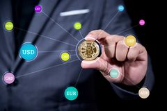 Businessman hand holding crytocurrency bitcoin connect with many royalty free stock photo