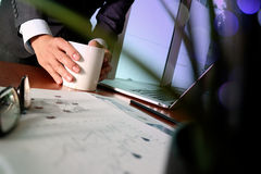 Businessman hand holding a cup of coffee Stock Image