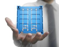Businessman hand holding 3d blue cargo container. Isolated on white background Royalty Free Stock Photos
