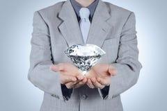 Businessman hand holding 3d diamond Royalty Free Stock Photography