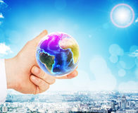 Businessman hand holding earth globe. On city background royalty free stock photos