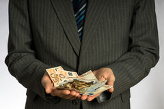 Businessman hand holding euro money. Royalty Free Stock Photo