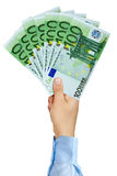 Businessman hand holding fan of 100 Euro Banknotes Royalty Free Stock Photo