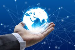 Businessman hand holding global network and global communication Royalty Free Stock Images