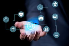 Businessman hand holding internet of things IoTs technology stock photo
