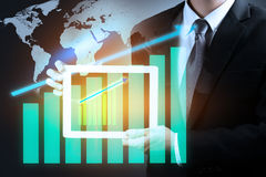 Businessman hand holding investment graph rise up on tablet.Elements of this image furnished by NASA.  stock images